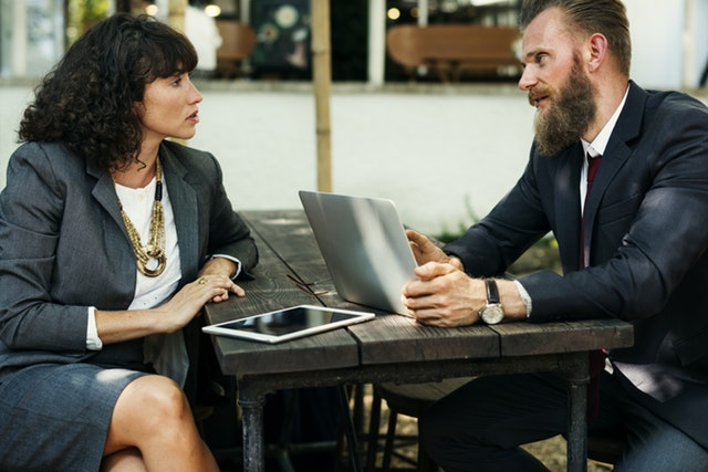 business man and woman chatting
